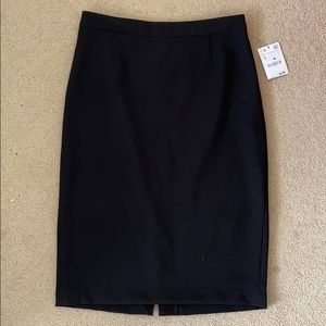 Zara black pencil skirt with button back detail